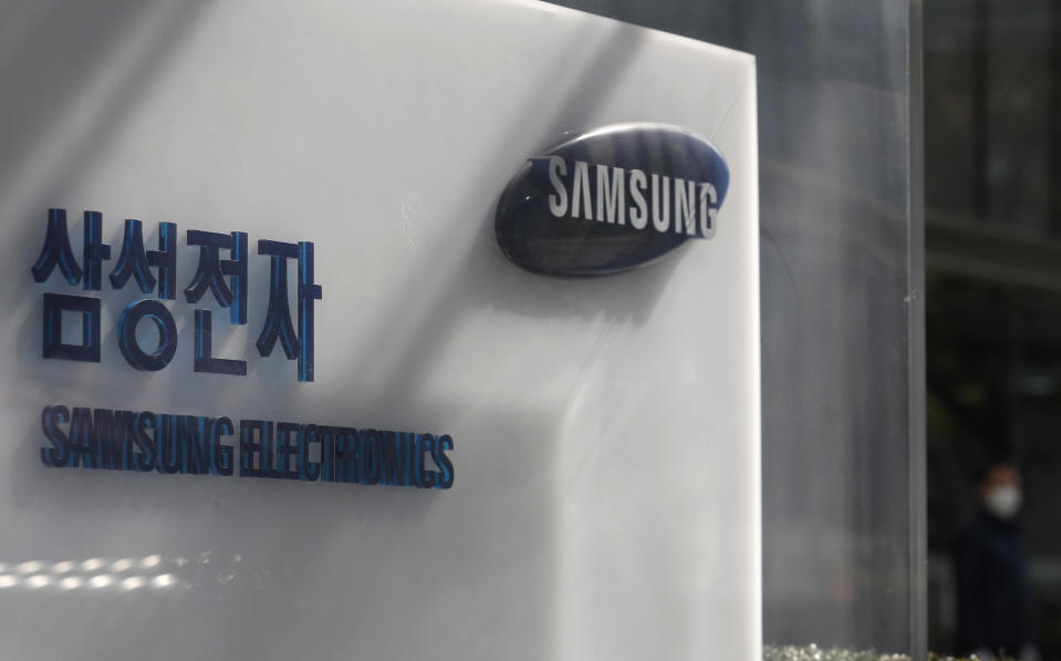 A logo of Samsung Electronics is seen outside of Samsung Electronics Seocho building in Seoul, South Korea, Sunday, Oct. 25, 2020. As Samsung Electronics mourns the death of its long-time chairman, Lee Kun-Hee, questions loom over what's next for South Korea's biggest company. Samsung has struggled for years to diversify from its core hardware business to tap new technologies and services.(AP Photo/Lee Jin-man)