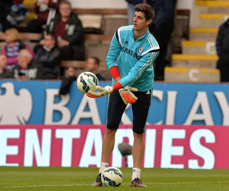 Chelsea's Belgian goalkeeper Thibaut Courtois warms up ahead of the English Premier League football match between Burnley and Chelsea at Turf Moor in Burnley, northwest England on August 18, 2014