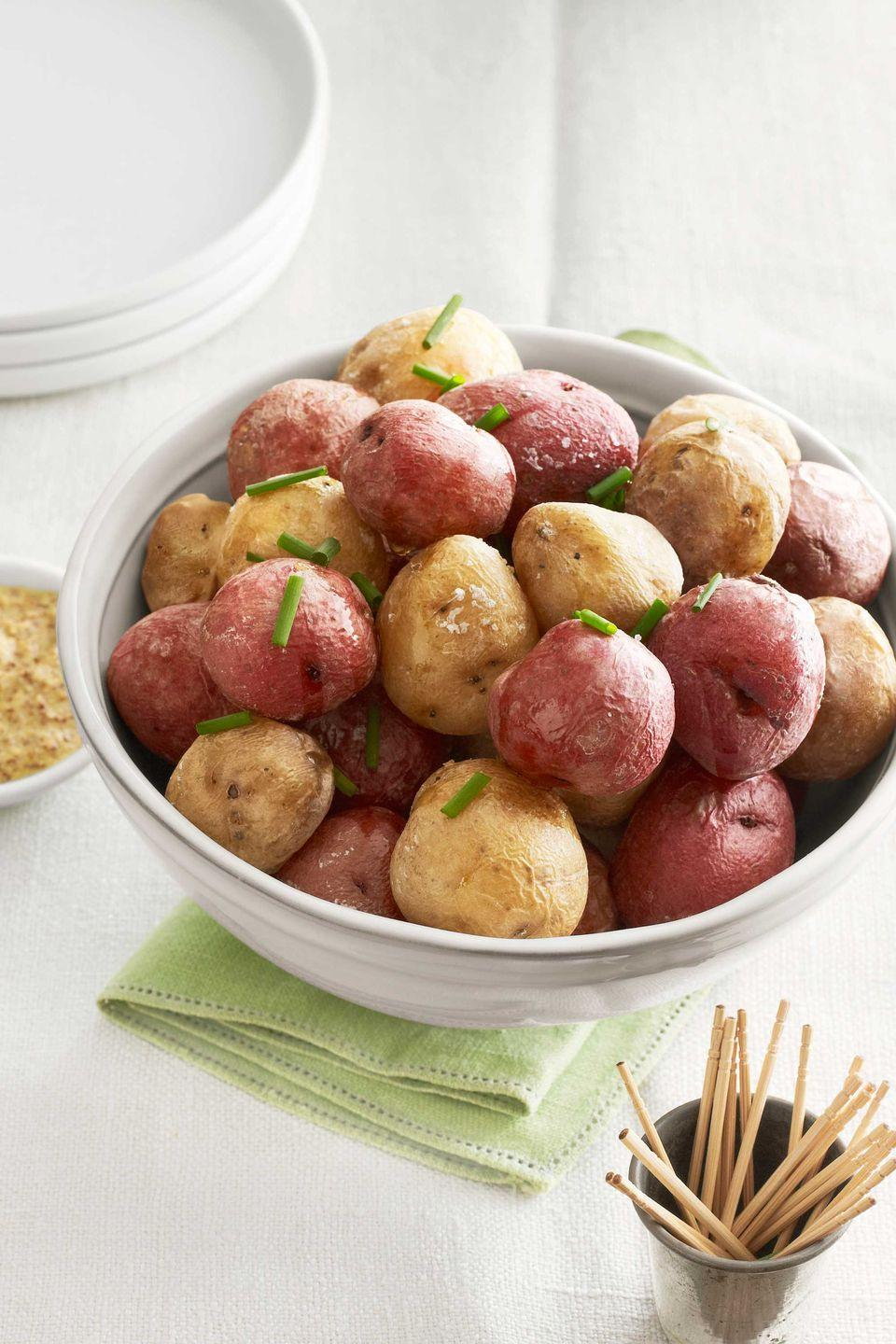 "<p>Coriander seeds, fennel seeds, and salt help flavor the crispy skin on these oven-baked potatoes.</p><p><strong><a href=""https://www.countryliving.com/food-drinks/recipes/a4167/salt-baked-new-potatoes-recipes-clv0513/"" rel=""nofollow noopener"" target=""_blank"" data-ylk=""slk:Get the recipe"" class=""link rapid-noclick-resp"">Get the recipe</a>.</strong></p>"