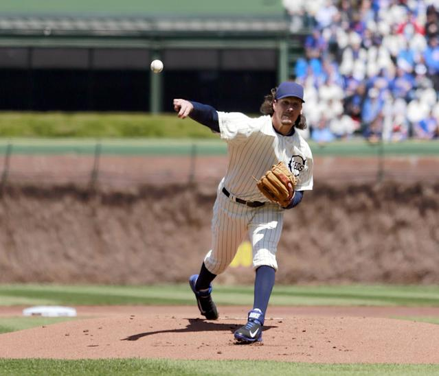 Chicago Cubs starting pitcher Jeff Samardzija delivers a pitch during the first inning at the 100th anniversary of the first baseball game at Wrigley Field against the Arizona Diamondbacks, Wednesday, April 23, 2014, in Chicago. (AP Photo/Charles Rex Arbogast)