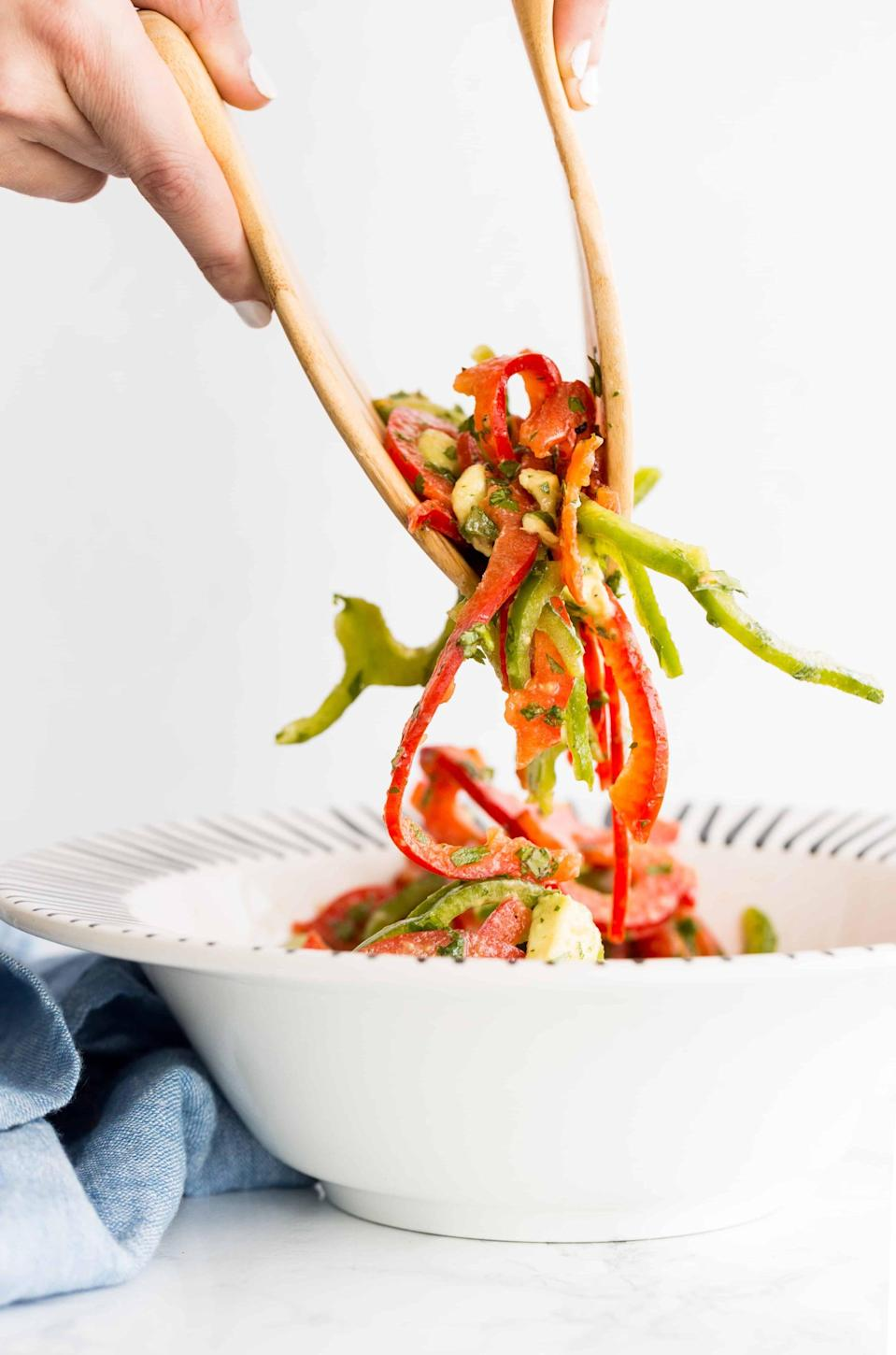 """<p>This avocado and bell pepper salad is a fresh and crunchy side to have on hand for every barbecue. It's also incredibly easy to put together - red and green bell peppers are cut up using a spiralizer, making preparation a breeze! Since this recipe was made to feed four, just cut it in half and you'll have the perfect amount for two people.</p> <p><strong>Get the recipe:</strong> <a href=""""http://inspiralized.com/avocado-and-bell-pepper-salad/"""" class=""""link rapid-noclick-resp"""" rel=""""nofollow noopener"""" target=""""_blank"""" data-ylk=""""slk:avocado and bell pepper salad"""">avocado and bell pepper salad</a></p>"""