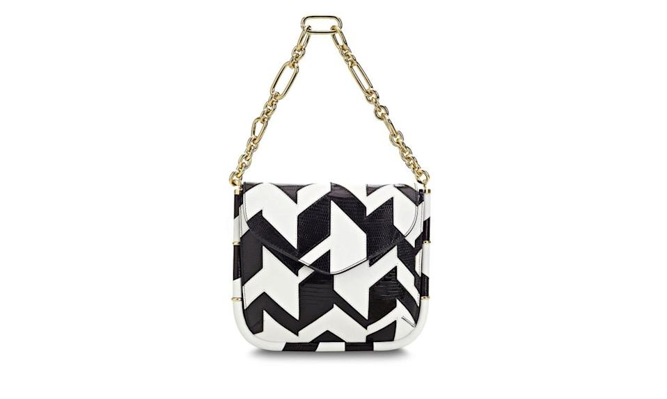 "<p>Leading the pack with the chain-mail handle, meet Ferragamo's newest addition to their leather goods. </p><p>Salvatore Ferragamo Black and White Lizard Chevron Handbag with Gold Chain, $2250, <a href=""http://www.ferragamo.com/shop/en/usa/handbags#pId=6148914691233707690"" rel=""nofollow noopener"" target=""_blank"" data-ylk=""slk:Salvatore Ferragamo"" class=""link rapid-noclick-resp"">Salvatore Ferragamo</a></p>"