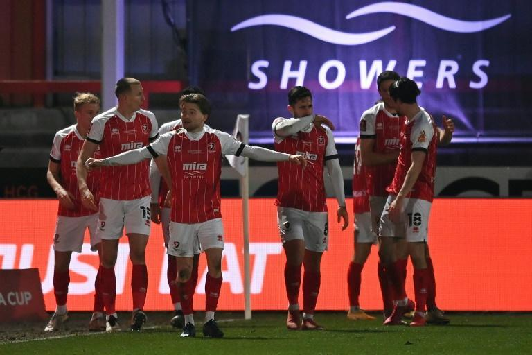 Cheltenham players celebrate Alfie May's goal in the FA Cup fourth round against Manchester City