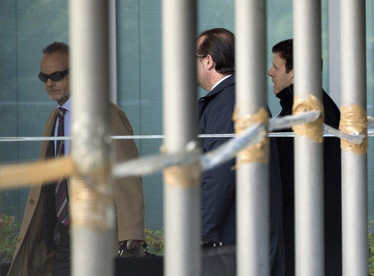 Dr Eufemiano Fuentes (R) arrives at the court house in Madrid on January 28, 2013