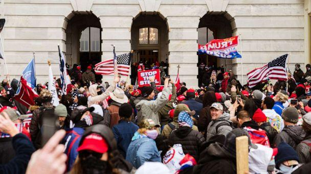 PHOTO: Supporters of President Donald Trump flood into the Capitol Building after breaking into it on Jan. 6, 2021, in Washington, D.C. (Jon Cherry/Getty Images)