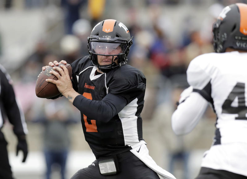Johnny Manziel would like to play for one of the two Texas XFL teams, but will he get that chance? (AP)