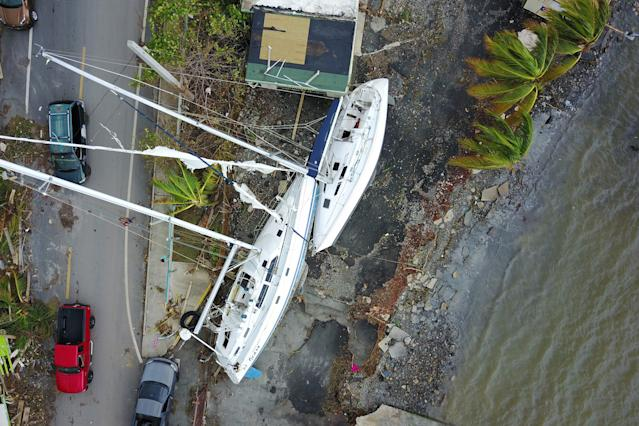 <p>Damaged sail boats washed ashore are seen in the aftermath of Hurricane Maria in Fajardo, Puerto Rico, Thursday, Sept. 21, 2017. (Photo: Ricardo Arduengo/AFP/Getty Images) </p>