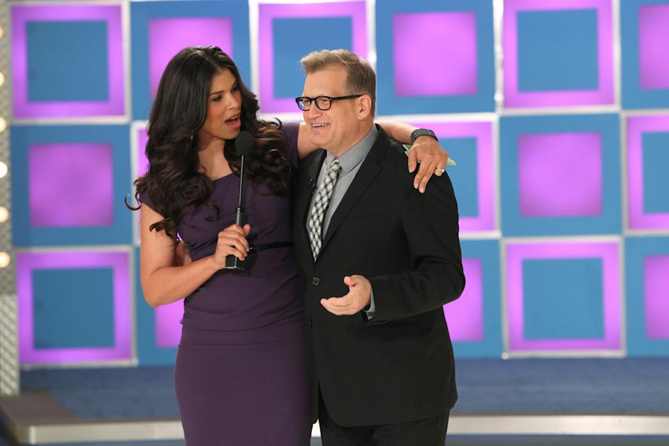 LOS ANGELES - FEBRUARY 21:  --Model Gwendolyn Osborne informs Drew Carey that the models are taking over the hosting duties for the show, and Carey and host George Grey will be doing the modeling, on THE PRICE IS RIGHT's April Fool's Day Special, Monday, April 1 (11:00 AM-12:00 Noon, ET; 10:00-11:00 AM, PT).     (Photo by Monty Brinton/CBS via Getty Images)