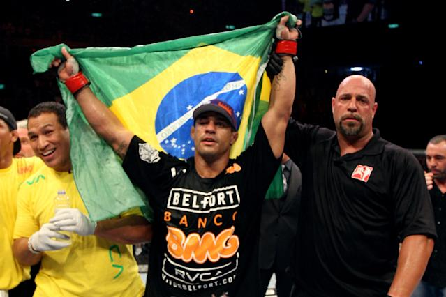 RIO DE JANEIRO, BRAZIL - JANUARY 14: Referee Dan Miragliotta (R) holds up Vitor Belfort (C) after defeating Anthony Johnson (not pictured) in a middleweight bout during UFC 142 at HSBC Arena on January 14, 2012 in Rio de Janeiro, Brazil. (Photo by Josh Hedges/Zuffa LLC/Zuffa LLC via Getty Images)