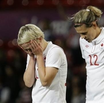 Canada's Sophie Schmidt, left, and her teammate Canada's Christine Sinclair, right, react after their team lost during their semifinal women's soccer match between the USA and Canada at the 2012 London Summer Olympics, in Manchester, England, Monday, Aug. 6, 2012. (AP Photo/Hussein Malla)