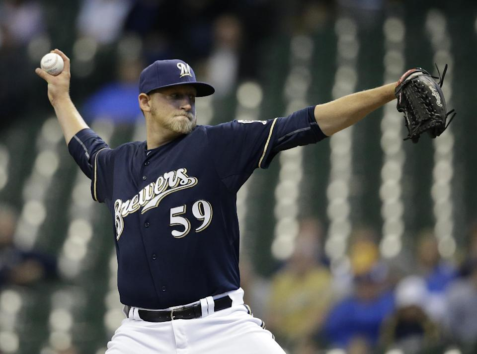 Milwaukee Brewers starting pitcher Tyler Wagner throws to the Arizona Diamondbacks during the first inning of a baseball game Sunday, May 31, 2015, in Milwaukee. (AP Photo/Jeffrey Phelps)