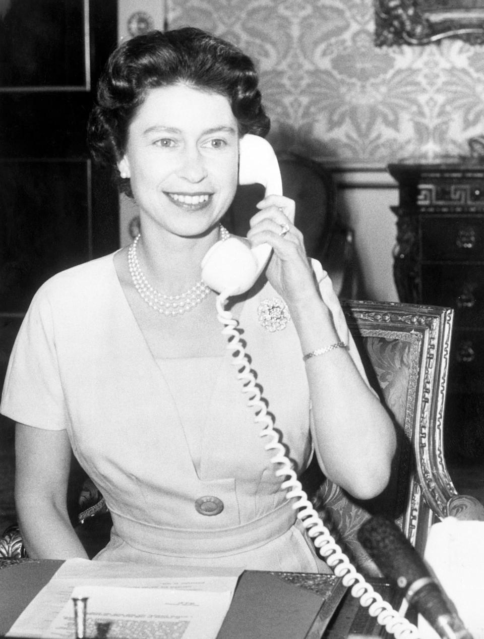<p>John Diefenbaker, Prime Minister of Canada, receives the first ever phone call to Ottawa from the Queen. She was inaugurating the CANTAT (Canadian Trans-Atlantic Telephone). (PA Archive) </p>