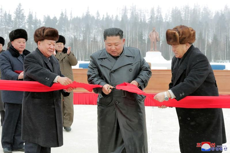 North Korean leader Kim Jong Un cuts the ribbon during a ceremony at the township of Samjiyon County