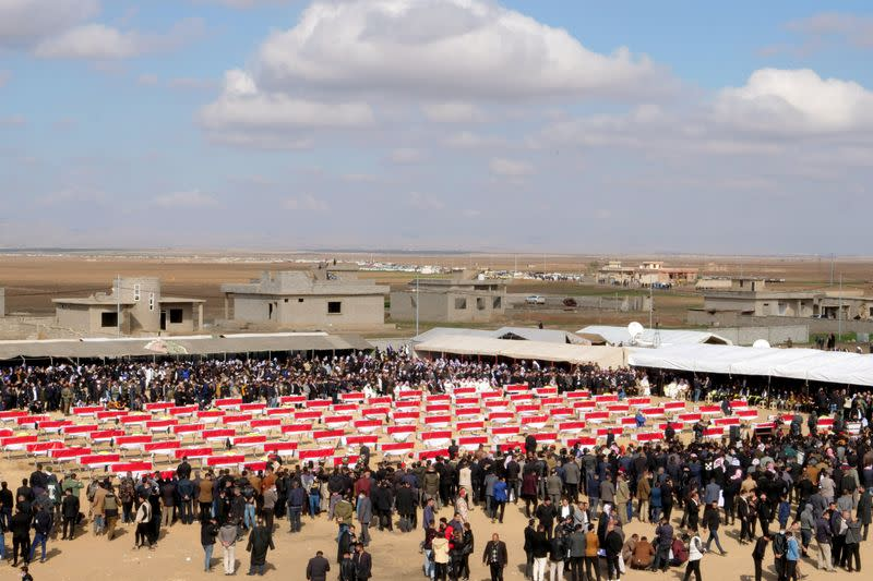 Coffins with remains of people from the Yazidi minority, who were killed by Islamic State militants, and they were exhumed from a mass grave, are seen during the funeral in Kojo