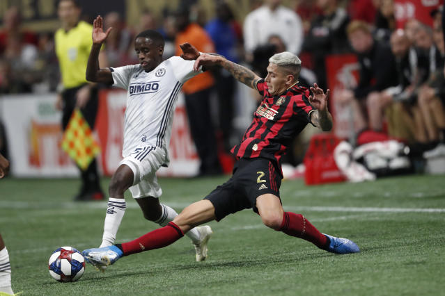 Atlanta United defender Franco Escobar (2) kicks the ball away from Philadelphia Union midfielder Jamiro Monteiro (35) during the first half of an MLS soccer Easter Conference semifinal Thursday, Oct. 24, 2019, in Atlanta. (AP Photo/John Bazemore)