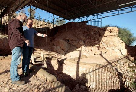 Professor Avi Gopher and Dr. Ran Barkai, researchers from Tel Aviv University's Institute of Archaeology, stand at Qesem cave, an excavation site near Rosh Ha'ayin
