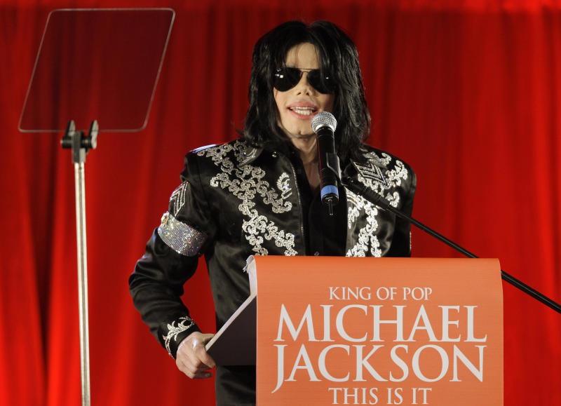 "FILE - In this March 5, 2009 file photo, US singer Michael Jackson announces that he is set to play ten live concerts at the London O2 Arena in July, which he announced at a press conference at the London O2 Arena. Jurors heard ""This Is It"" Director Kenny Ortega recount Jackson's brilliance and frailties during an emotional testimony in Los Angeles on Wednesday, July 10, 2013, in a case filed by Jackson's mother Katherine Jackson, against concert promoter AEG Live LLC. (AP Photo/Joel Ryan, File)"