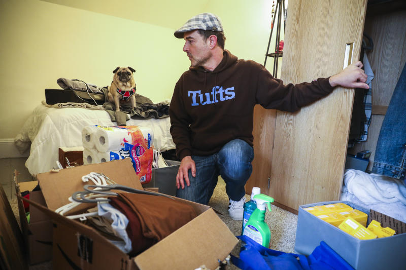 SOMERVILLE, MA - MARCH 12: Tufts University student Mark Beckwith becomes overwhelmed while packing up his dorm room with his service dog, Matilda, at his side on March 12, 2020 in Somerville, MA. In the wake of the continued increase of coronavrius cases statewide, Tufts University closed their campus and asked students to leave their student housing by Sunday. Beckwith, however, has significant health and financial considerations that would make leaving campus virtually impossible. Although he has applied for an exemption from Tufts administration that would allow him to stay, he won't know until the weekend and must pack his belongings while he waits for the news. (Photo by Erin Clark for The Boston Globe via Getty Images)