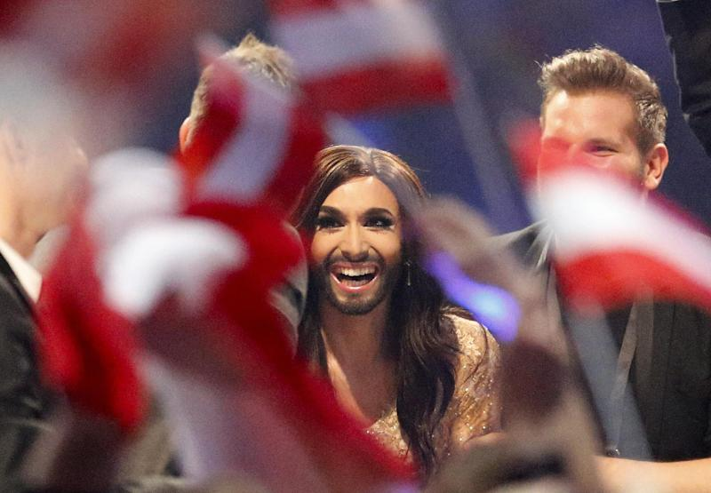 Singer Conchita Wurst representing Austria who performed the song 'Rise Like a Phoenix' listens as points are announced during the judging at the final of the Eurovision Song Contest in the B&W Halls in Copenhagen, Denmark, Saturday, May 10, 2014. (AP Photo/Frank Augstein)