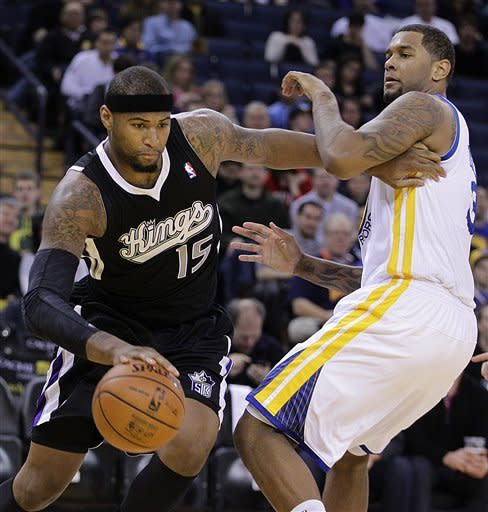 Sacramento Kings' DeMarcus Cousins, left, drives past Golden State Warriors' Jeremy Tyler during the first half of an NBA basketball game Saturday, March 24, 2012, in Oakland, Calif. (AP Photo/Ben Margot)