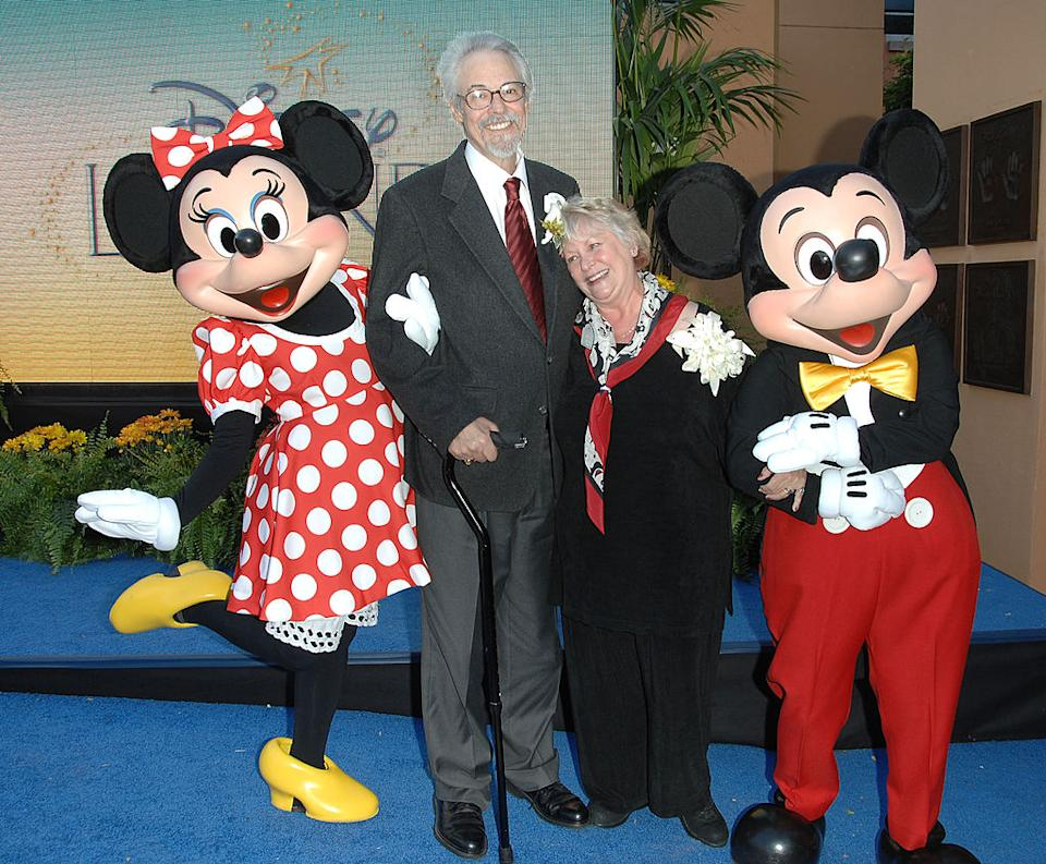 Real-life husband and wife Wayne Allwine and Russi Taylor pose with Minnie and Mickey Mouse, the characters they voiced for decades, on Oct. 13, 2008, at Walt Disney Studios in Burbank, Calif. (Photo: Stephen Shugerman/Getty Images)