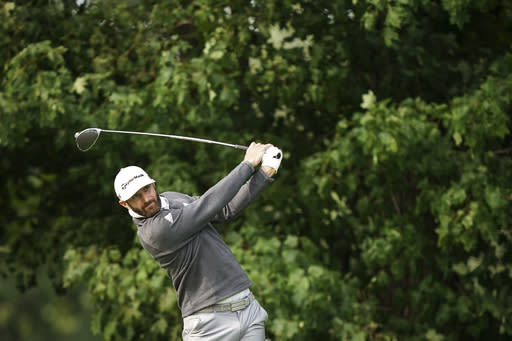 Dustin Johnson tees off on the 12th hole during practice before the U.S. Open Championship golf tournament at Winged Foot Golf Club, Tuesday, Sept. 15, 2020, in Mamaroneck, N.Y. (AP Photo/John Minchillo)