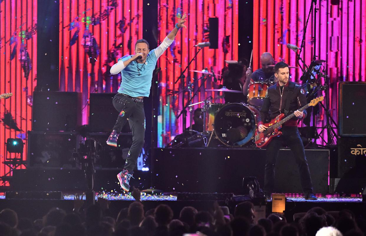 Chris Martin of Coldplay with the Chainsmokers on stage at the BRIT Awards 2017, held at The O2 Arena, in London.  Picture date Tuesday February 22, 2017. Picture credit should read Matt Crossick/ EMPICS Entertainment. Editorial Use Only - No Merchandise.