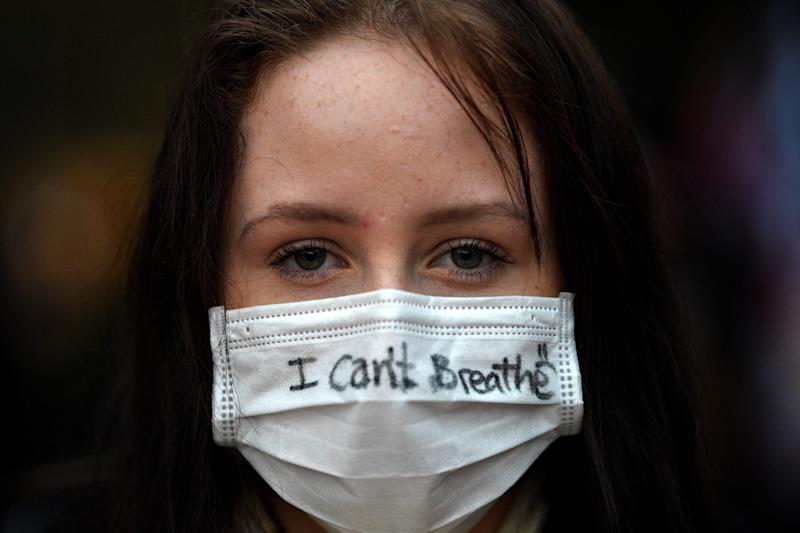 A protester wears a face mask during a rally for justice in Sydney on June 2, 2020, against the deaths of members of the Aboriginal community in Australia and the death of George Floyd. (Photo: SAEED KHAN via Getty Images)