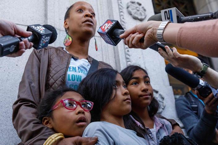 """<div class=""""inline-image__title""""> 1202363783 </div> <div class=""""inline-image__caption""""> <p>Demetria Hester speaks to the media while holding her daughters outside the courthouse after Jeremy Christian was found guilty of first-degree murder on February 21, 2020 in Portland, Oregon.</p> </div> <div class=""""inline-image__credit""""> Photo by JOHN RUDOFF/AFP via Getty Images </div>"""