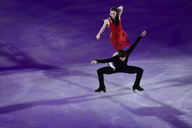 <p>Canada's Scott Moir and Canada's Tessa Virtue perform during the figure skating gala event during the Pyeongchang 2018 Winter Olympic Games at the Gangneung Oval in Gangneung on February 25, 2018. / AFP PHOTO / ARIS MESSINIS (Photo credit should read ARIS MESSINIS/AFP/Getty Images) </p>