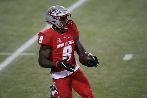 New Mexico safety Jerrick Reed II (9) runs with the ball after making an interception against Nevada during the first half of an NCAA college football game Saturday, Nov. 14, 2020, in Las Vegas. (AP Photo/John Locher)