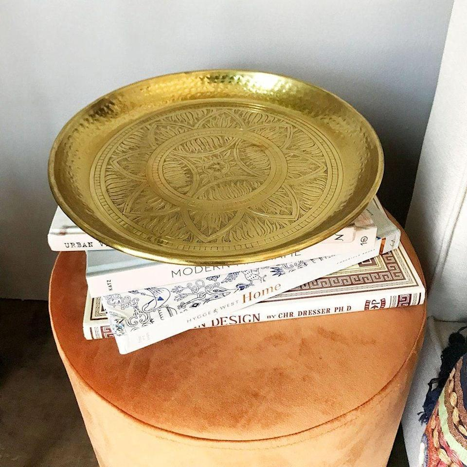 <p>This <span>Gold Emboss Tray</span> ($78) is a great accent piece that will make a chic addition to the living room.</p>