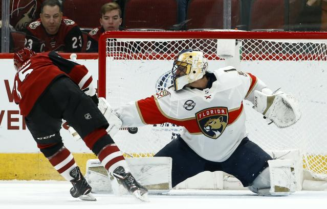 Arizona Coyotes center Nick Cousins, left, scores a goal against Florida Panthers goaltender Roberto Luongo during the shootout in an NHL hockey game Tuesday, Feb. 26, 2019, in Glendale, Ariz. The Coyotes won 4-3. (AP Photo/Ross D. Franklin)