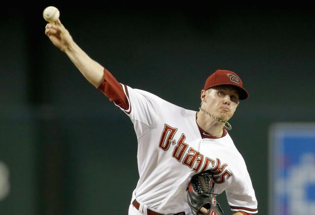 Arizona Diamondbacks' Chase Anderson throws a pitch against the Detroit Tigers during the first inning of a baseball game on Tuesday, July 22, 2014, in Phoenix. (AP Photo)