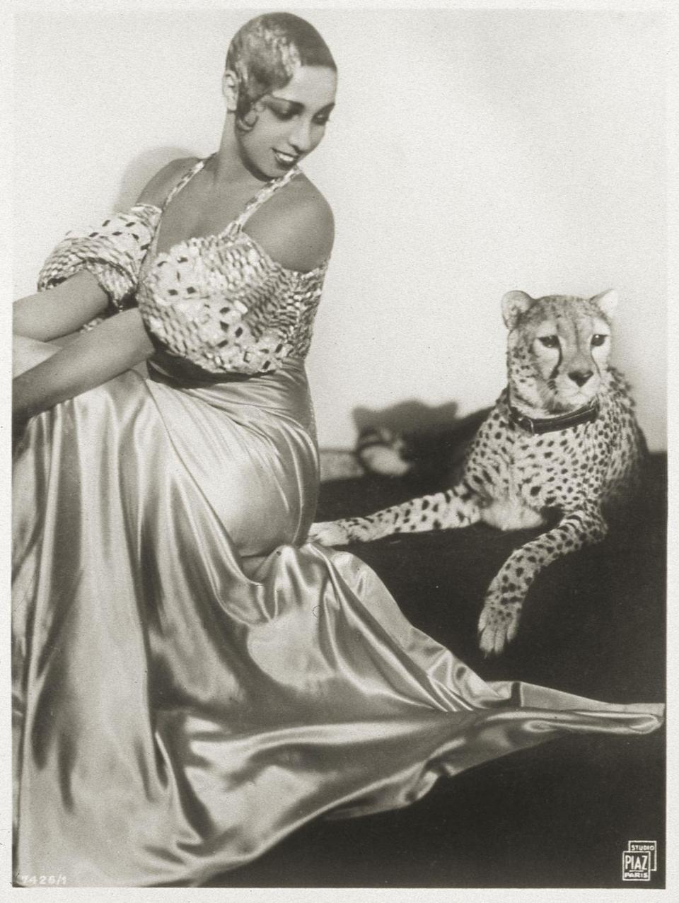 """<p>Josephine Baker was given her pet cheetah, Chiquita, as a <a href=""""https://www.mentalfloss.com/article/23148/5-things-you-didnt-know-about-josephine-baker"""" rel=""""nofollow noopener"""" target=""""_blank"""" data-ylk=""""slk:gift from her nightclub's owner"""" class=""""link rapid-noclick-resp"""">gift from her nightclub's owner</a> for her to use in her act. However, after the show ended, Josephine kept Chiquita as a personal pet. But her Cheetah wasn't the only pet in her life: The entertainer also had a pet goat named Toutoute and a pig named Albert. </p>"""
