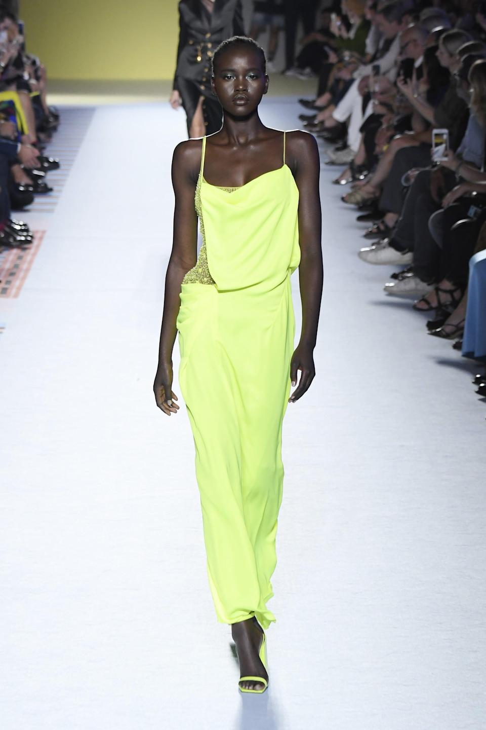 """<p>Born in a refugee camp in South Sudan, Adut Akech has not forgotten her roots as she climbs the ladder to fashion stardom. A few years after being signed at age 16, she walked in <a href=""""https://www.popsugar.com/fashion/Saint-Laurent-Spring-2017-Collection-42467446"""" class=""""link rapid-noclick-resp"""" rel=""""nofollow noopener"""" target=""""_blank"""" data-ylk=""""slk:Saint Laurent's Spring 2017 show"""">Saint Laurent's Spring 2017 show</a>, her breakout moment. Her career has since skyrocketed, closing shows for Valentino and Alexander McQueen and appearing on the covers of <strong>i-D</strong>, <strong>British Vogue</strong>, and other publications.</p>"""