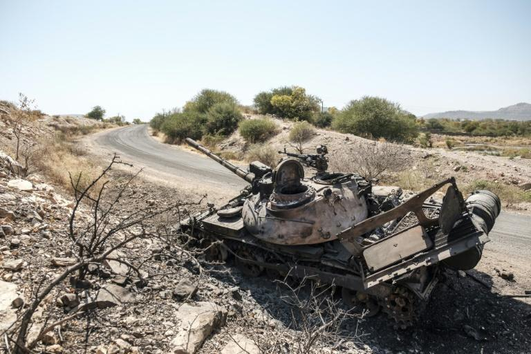 A burnt-out tank on the road to the northern farming Tigray town of Humera, which suffered intense fighting