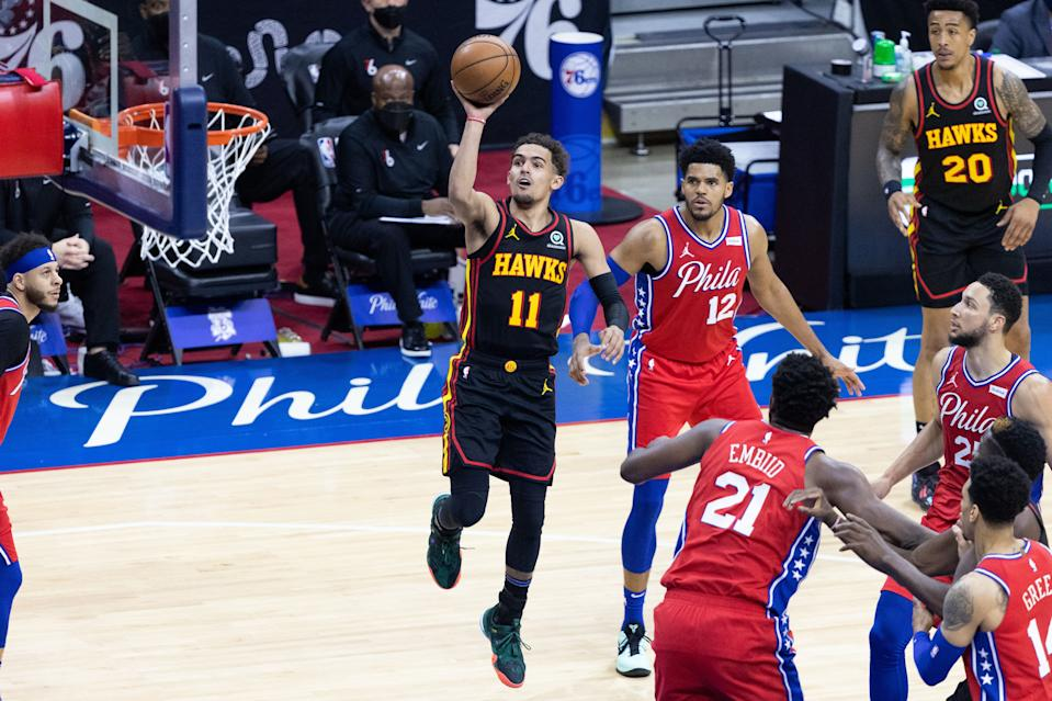 Hawks star Trae Young had the whole Sixers' defense watching. (Bill Streicher/USA Today Sports via Reuters)