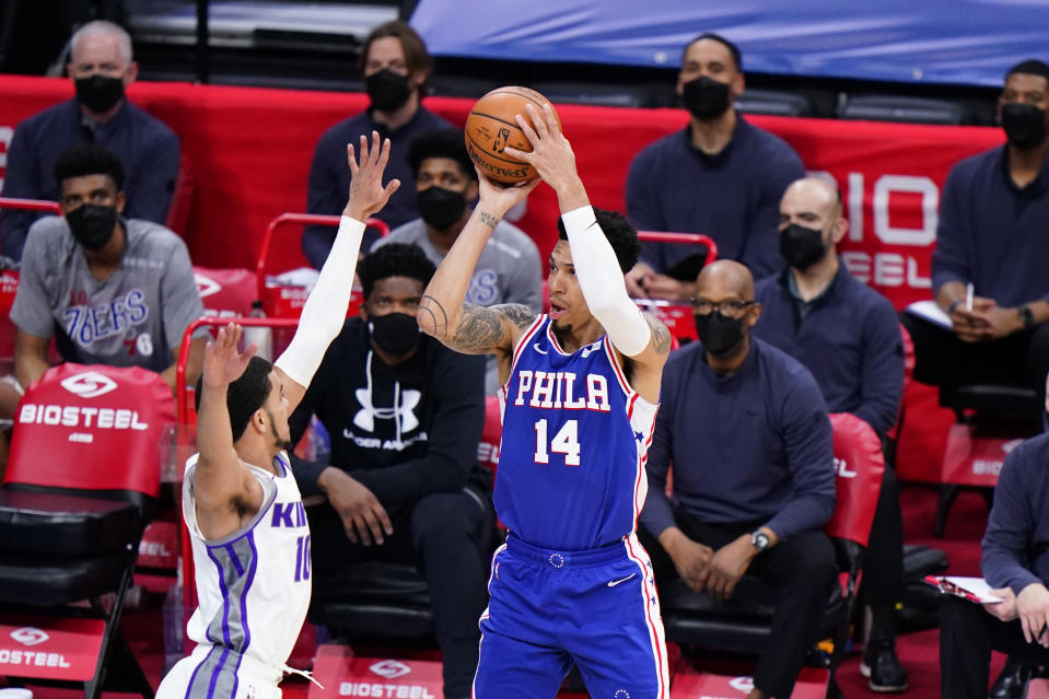 Philadelphia 76ers' Danny Green (14) goes up for a shot against Sacramento Kings' Justin James (10) during the first half of an NBA basketball game, Saturday, March 20, 2021, in Philadelphia. (AP Photo/Matt Slocum)