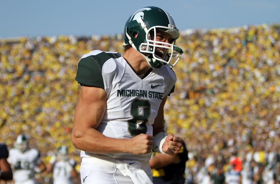 Oct. 9, 2010: Michigan State 34, Michigan 17, Michigan Stadium: MSU quarterback Kirk Cousins celebrates a Spartans touchdown.