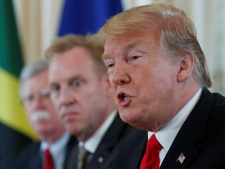 U.S. President Donald Trump speaks as acting Defense Secretary Patrick Shanahan and National Security Advisor John Bolton look on during a meeting with Caribbean leaders at Mar-a-Lago in Palm Beach, Florida, U.S., March 22, 2019. REUTERS/Kevin Lamarque