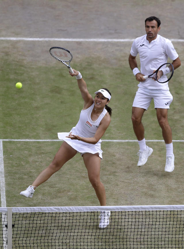 Taiwan's Latisha Chan, left, and Croatia's Ivan Dodig in action against Latvia's Jelena Ostapenko and Sweden's Robert Lindstedt during the mixed doubles final match of the Wimbledon Tennis Championships in London, Sunday, July 14, 2019. (AP Photo/Kirsty Wigglesworth)