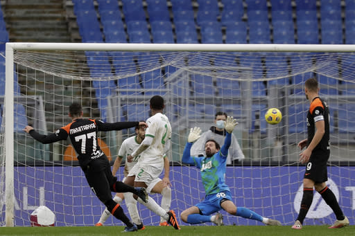 Roma's Henrikh Mkhitaryan, left shoots to score but the goal was disallowed during a Serie A soccer match between Roma and Sassuolo at the Olympic Stadiumin Rome, Italy, Sunday, Dec. 6, 2020. (AP Photo/Andrew Medichini)