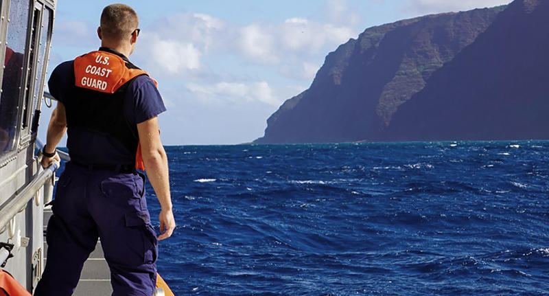In this photo released by the U.S. Coast Guard, Coast Guard Cutter William Hart moves toward the Na Pali Coast on the Hawaiian island of Kauai on Friday, Dec. 27, 2019, the day after a tour helicopter disappeared with seven people aboard. Authorities say wreckage of the helicopter has been found in a mountainous area on the island. (Lt. j.g. Daniel Winter/U.S. Coast Guard via AP)