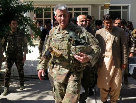 U.S. Army General John Nicholson, commander of Resolute Support forces and U.S. forces in Afghanistan, walks with Afghan officials during an official visit in Farah province, Afghanistan May 19, 2018. REUTERS/James Mackenzie