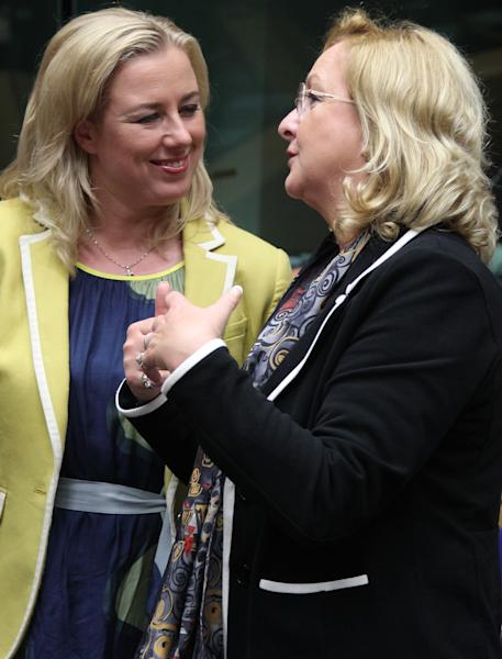 Finnish Finance Minister Jutta Urpilainen, left, talks with Austrian Finance Minister Maria Fekter, during the EU finance ministers meeting, in Brussels, Wednesday, June 26, 2013. European Union finance ministers are making a fresh attempt to set up rules on how to distribute the cost of failing banks without letting taxpayers foot the bill. The EU's 27 finance ministers are set to gather for an emergency meeting in Brussels after they failed to reach an agreement on the legislation in 19 hours of negotiations last week. (AP Photo/Yves Logghe)