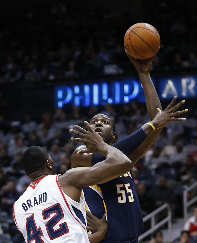 Indiana Pacers center Roy Hibbert (55) takes a shot against Atlanta Hawks power forward Elton Brand (42) in the first half of an NBA basketball game, Tuesday, Feb. 4, 2014, in Atlanta. (AP Photo/John Bazemore)