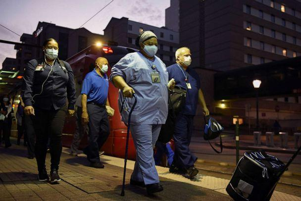 PHOTO: Healthcare workers walk through the Texas Medical Center during a shift change as cases of COVID-19 spike in Houston, July 8, 2020. (Callaghan O'Hare/Reuters)