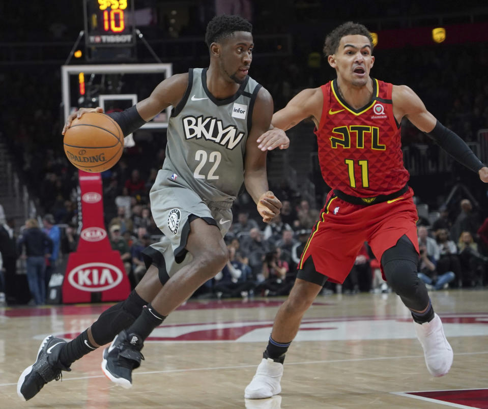 Brooklyn Nets' Caris LeVert (22) drives around Atlanta Hawks Trae Young (11) in the first half of an NBA basketball game Friday, Feb. 28, 2020, in Atlanta. (AP Photo/Tami Chappell)
