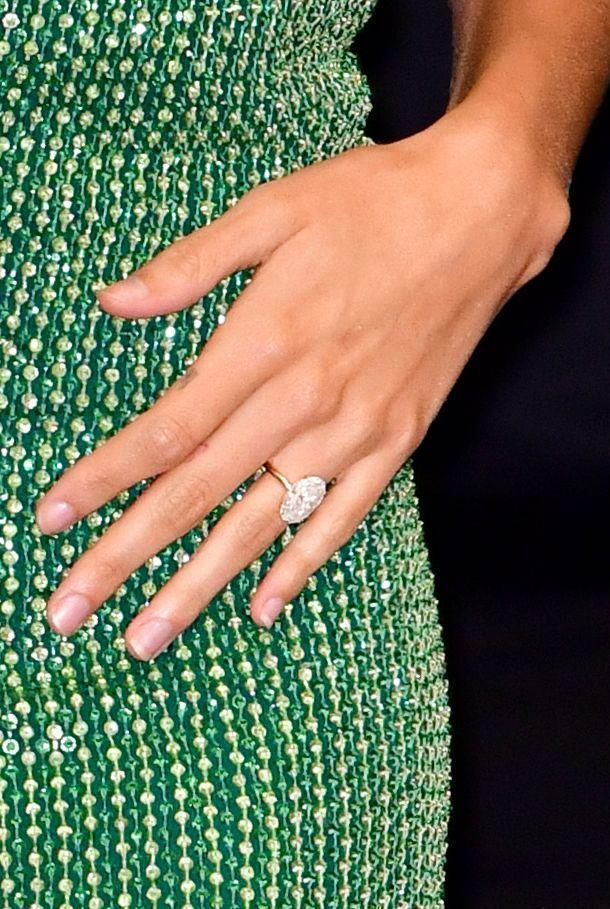 "<p>The biggest trend in 2020 is large oval-shaped solitaire stones on a thin band — either pavé or plain. The simple band lets the diamond stand on its own, which is especially stunning if your diamond is <a href=""https://www.vogue.com/article/hailey-justin-bieber-reveal-wedding-rings"" rel=""nofollow noopener"" target=""_blank"" data-ylk=""slk:between 6 to 8 carats"" class=""link rapid-noclick-resp"">between 6 to 8 carats</a>, like Hailey Bieber's.</p>"